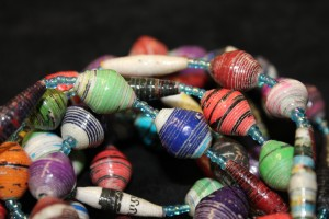A popular way of making beads by rolling up long thin strips of coloured paper Kenya