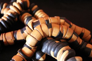 Baye Fall necklaces made out of wooden beads in diffferent shapes