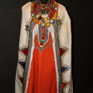 Berber traditional costume from the Draa Valley Amber is worn in abundance to show the wealth and status of the husband
