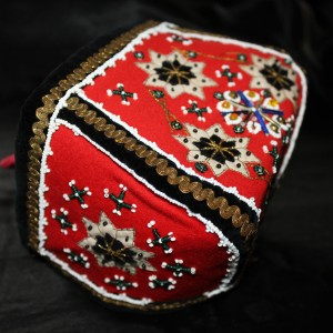 A richly decorated headgear for girls used traditionally in Hardanger area of Norway. The patterns and way of embroidering the beads