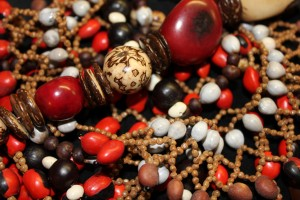 Seed beads of different size and colour (Lucky Beans, Job's Tears and larger fruit stones)