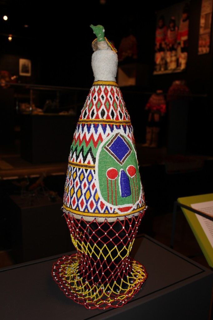 The Yuroba people of Nigeria use beaded items richly decorated with symbols from their religion This is a crown ment for the local kings to use