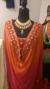 Deatails of a Indian sari richly decorated with beads and fabrics